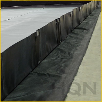 secondary containment berm underlayment to protect against punctures
